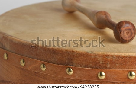 Traditional goatskin irish drum - the bodhran. - stock photo