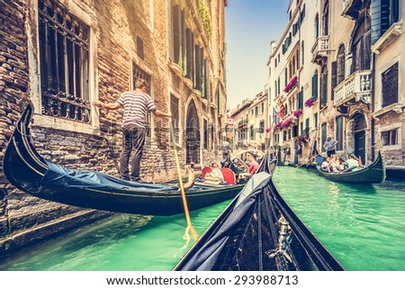 Traditional Gondolas on canal in Venice, Italy with retro vintage grunge Instagram style filter and lens flare effect - stock photo
