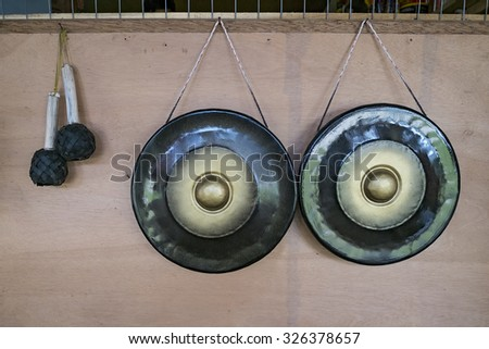 Traditional gongs for sale on display during Sunday market at the village in Kudat Sabah, Borneo, Malaysia - stock photo