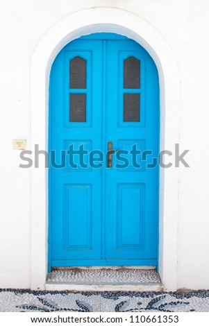 Traditional greek blue doors in white building - stock photo