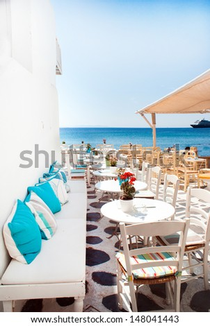 Traditional greek cafeteria on Mykonos island, Greece - stock photo