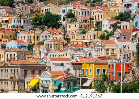 Traditional greek colorful houses in Symi island. Dodecanese, Greece. - stock photo