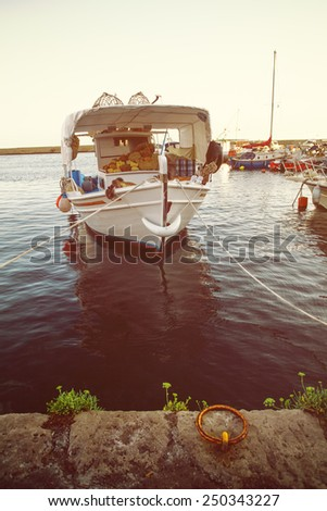 Traditional Greek culture. Mining sponges boats on sea, impressions of Greece - stock photo