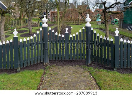 traditional green wooden fence - stock photo