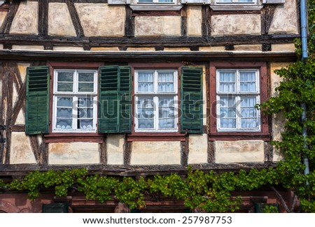 Traditional half-timbered houses in the streets of the small town of Wissembourg in Alsace, France - stock photo