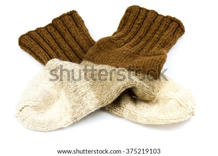 Traditional hand-knit wool socks in three colors - stock photo