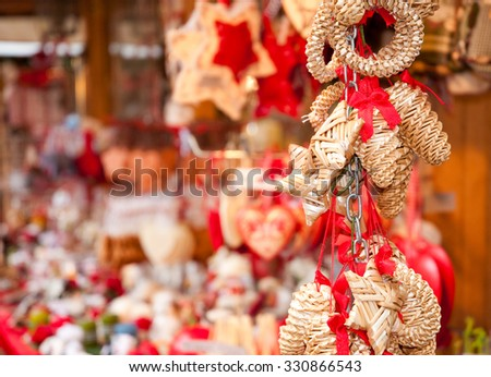 Traditional hand made Christmas decorations on Christmas market  - stock photo
