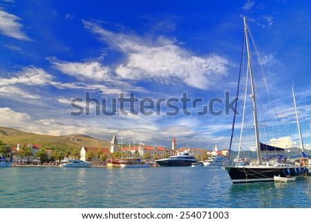 Traditional harbor with sail boats at anchor, Trogir, Croatia - stock photo