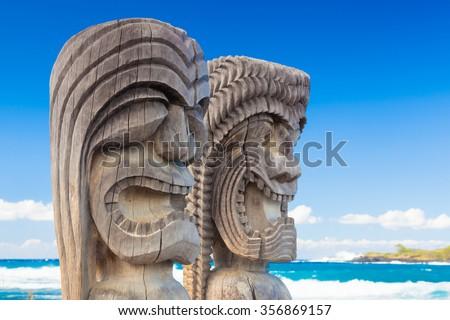 Traditional Hawaiian wood carving of guards at ancient Hawaiian site Pu'uhonua O Honaunau National Historical Park on Big Island, Hawaii - stock photo