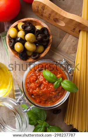 Traditional homemade tomato sauce with spaghetti and ingredients. Italian healthy food background. View from above. - stock photo