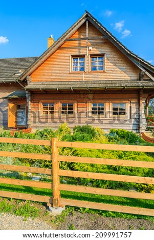 Traditional house built in mountain style in countryside area near Krakow, Poland - stock photo