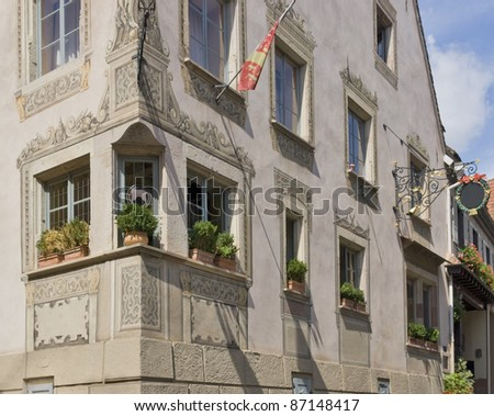 traditional house facade in Mittelbergheim, a village of a region in France named Alsace - stock photo