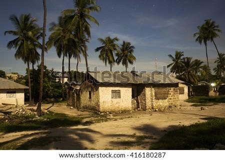 Traditional house from Zanzibar village at night at full moon light - stock photo