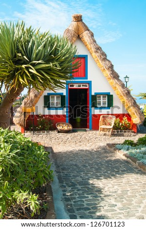 Traditional house of first settlers at Santana, Madeira - stock photo