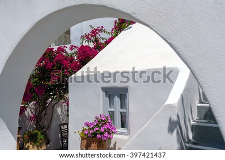 Traditional house of Santorini island with arch in front of it - stock photo