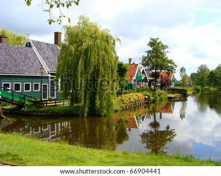 Traditional houses along a canal in Holland - stock photo