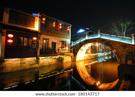 Traditional Houses and a Bridge Over a Canal, Suzhou, China - stock photo