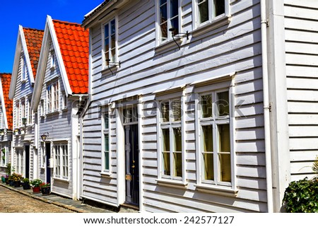 Traditional houses and the road, covered with bricks - stock photo