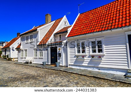 Traditional houses and the road, covered with stones - stock photo