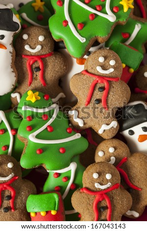 Traditional Iced Gingerbread Christmas Cookies with Trees and Snowmen - stock photo