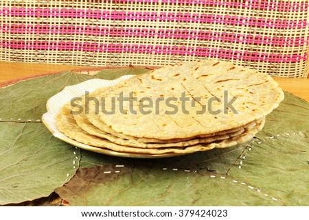 traditional indian home made roti chapati paratha indian flat bread or indian tortilla nan - stock photo