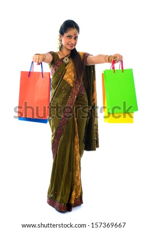 traditional indian woman doing diwali shopping with isolated white background - stock photo
