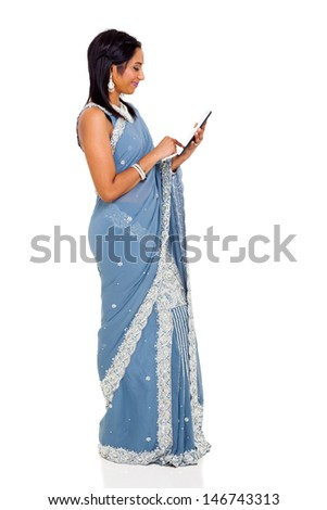 traditional indian woman in sari using tablet computer - stock photo