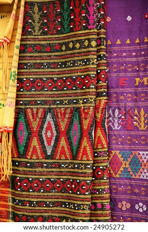 Traditional Indonesian batik embroidery in colorful motifs. - stock photo