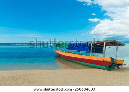 Traditional indonesian fisherman boat at pacific island - stock photo