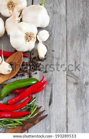 Traditional ingredients of italic cuisine - garlic, peppers, rosemary. Selective focus. Side copy space background. - stock photo