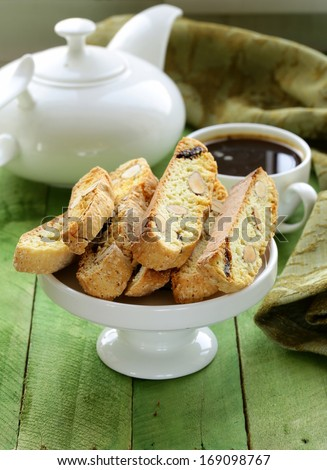 traditional Italian biscotti cookies (cantucci) on a wooden table - stock photo