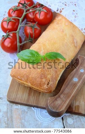 traditional Italian ciabatta bread with tomato and basil - stock photo