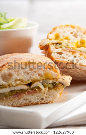 traditional Italian ciabatta panini sandwich chicken vegetables and aioli - stock photo