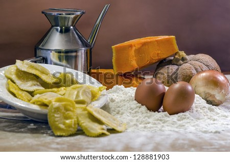 Traditional Italian cuisine with ingredients - stock photo