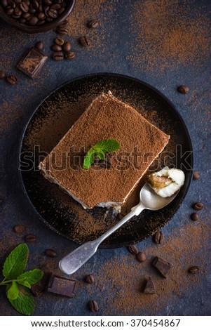 Traditional italian dessert tiramisu on blake plate. top view - stock photo
