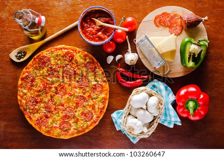 Traditional italian homemade pepperoni pizza and ingredients - stock photo