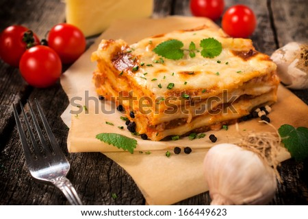 Traditional Italian lasagna with beef meat.Selective focus on the lasagna - stock photo