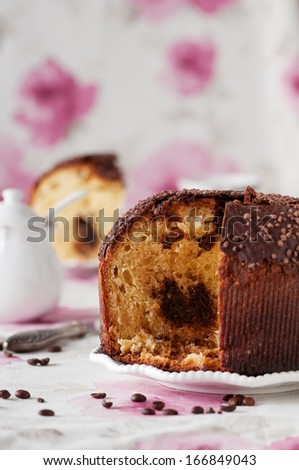 Traditional Italian panettone with coffee and chocolate, selective focus - stock photo