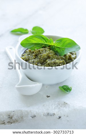 Traditional Italian pesto sauce with basil and olive oil - stock photo