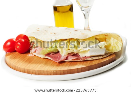 Traditional Italian piadina on the white background - stock photo