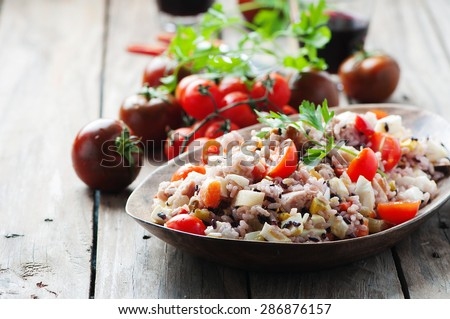 Traditional italian rice salad with tuna and vegetables, selective focus - stock photo