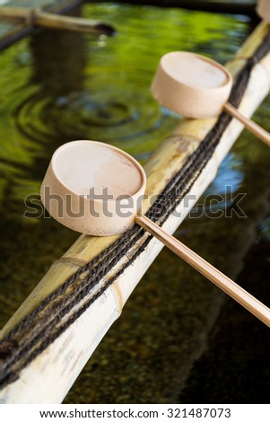 Traditional Japanese bamboo fountain dripping water - stock photo