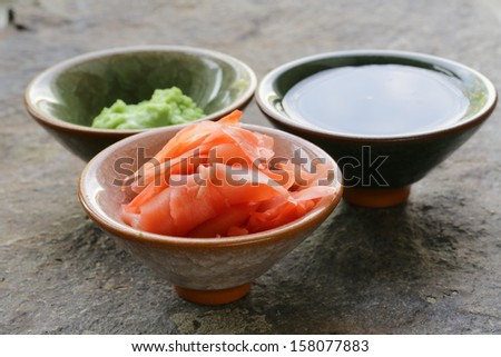 traditional Japanese condiments - wasabi, ginger and soy sauce - stock photo