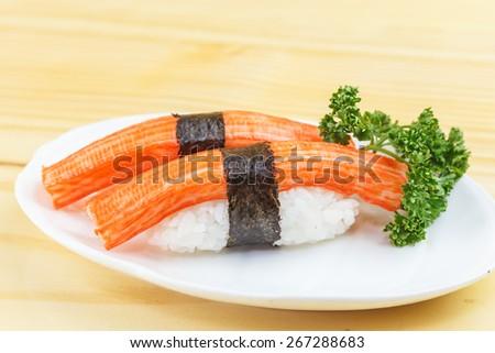 Traditional japanese food, Immitation Crab Sticks or Kani Kamaboko sushi on wooden table - stock photo