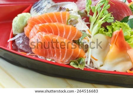 Traditional japanese food, Mix fresh fish sashimi on wooden table - stock photo