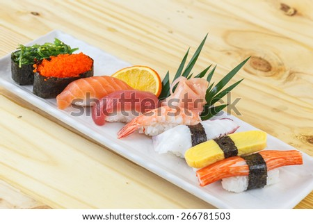 Traditional japanese food, Mix sushi set on wooden table - stock photo