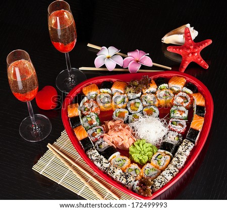 Traditional Japanese food Sushi. Closeup japanese sushi on a bamboo napkin. Sushi collection in valentines day. - stock photo