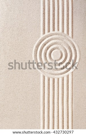 Traditional Japanese sand zen garden with a raked pattern of concentric circles and straight parallel lines with copy space, a place of spirituality and tranquility - stock photo