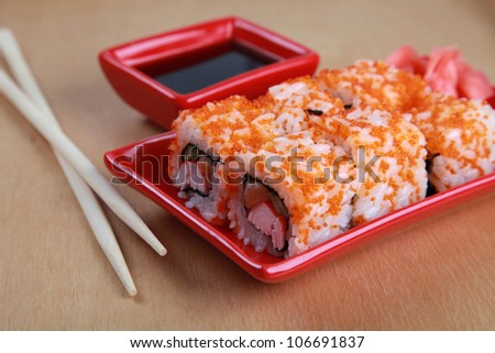 Traditional Japanese Sushi rolls with crabs, salmon, caviar and rice - stock photo