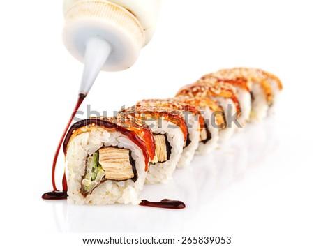 Traditional japanese sushi  with sauce isolated on white background - stock photo